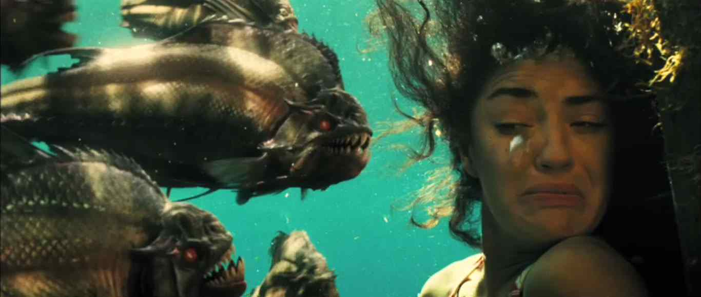 The movie poster for the movie Piranha directed by Alexandre Aja.
