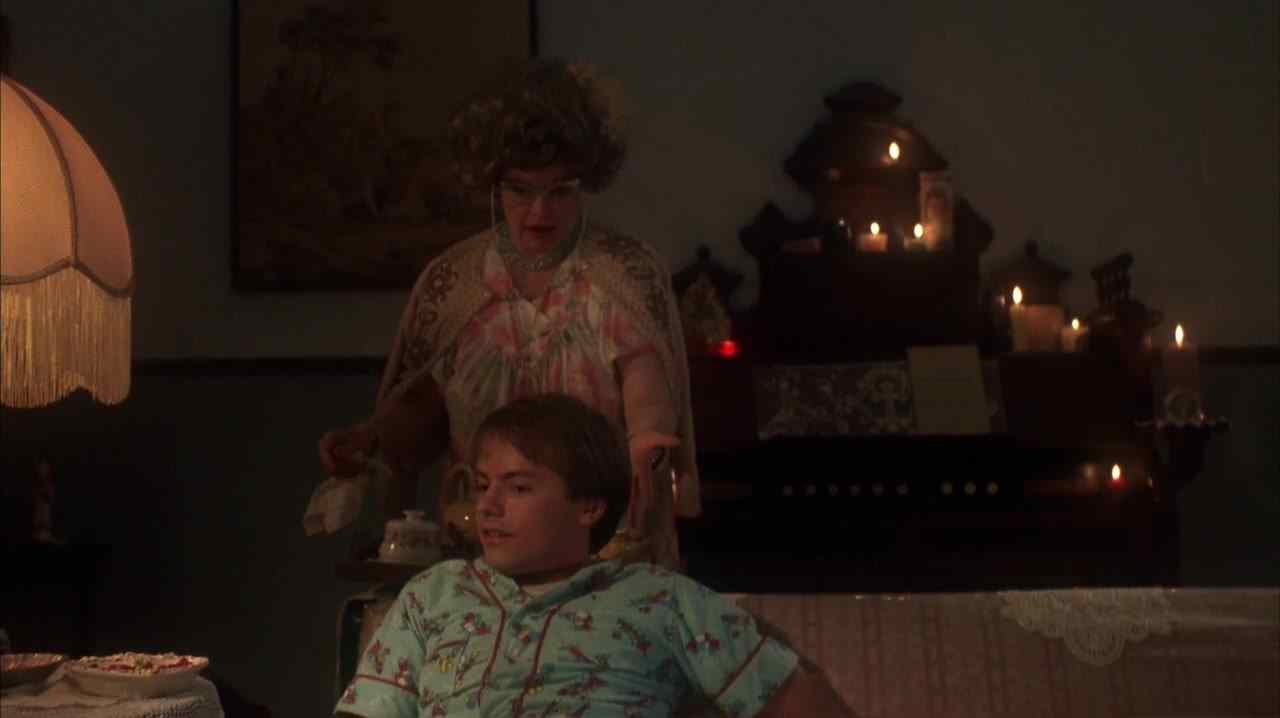Hoax (Stephen Geoffreys) on the couch after being reprimanded by his mother in Robert Englund's 976-Evil.