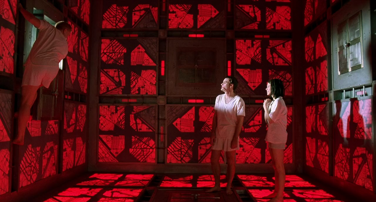 The cast of Vincenzo Natali's 1997 sci-fi, horror film Cube entering the red room.