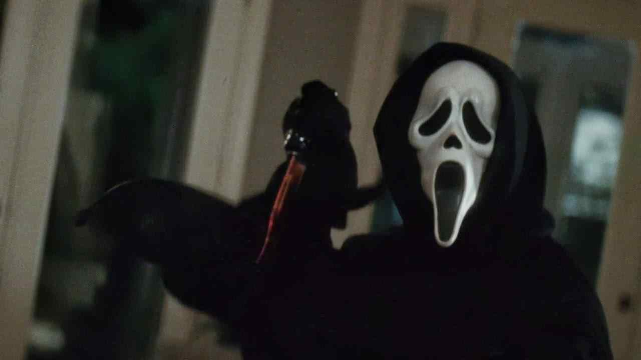 Ghostface, in Wes Craven's modern slasher classic Scream, with a bloody knife.