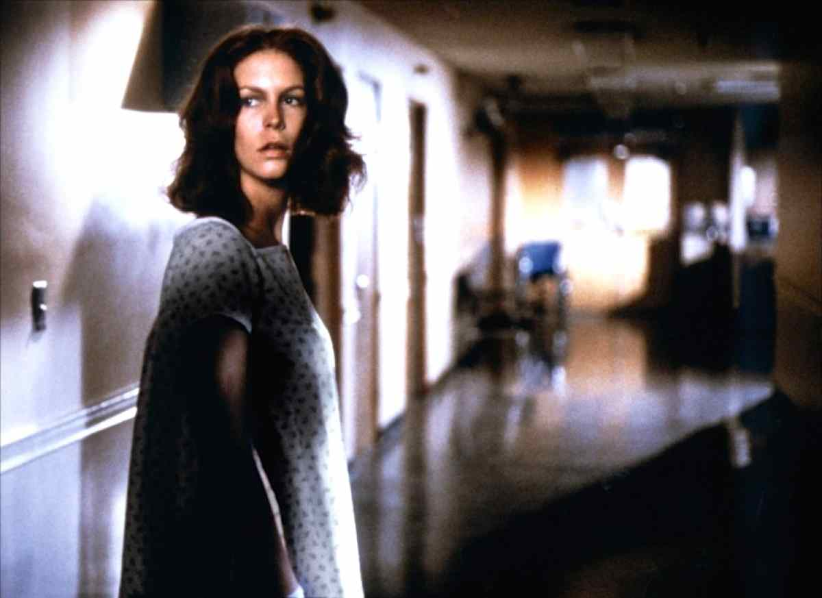 Laurie Strode (Jamie Lee Curtis) in a hospital gown in Rick Rosenthal's underrated slasher sequel Halloween II (1981).
