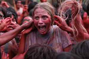 Civilization being caressed by cannibals in Eli Roth's Green Inferno.