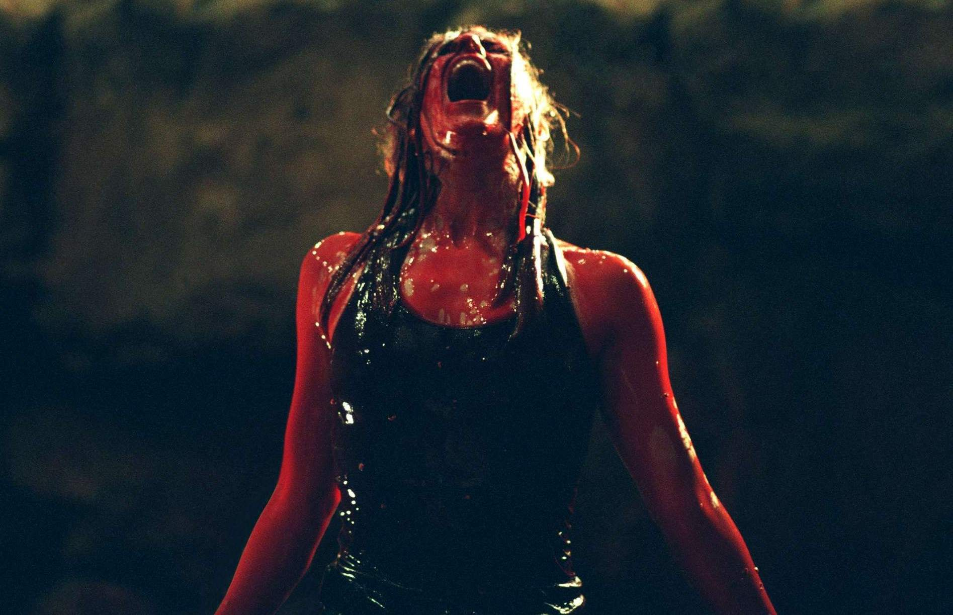 Sarah emerges from the lake of blood after killing several monsters in The Descent