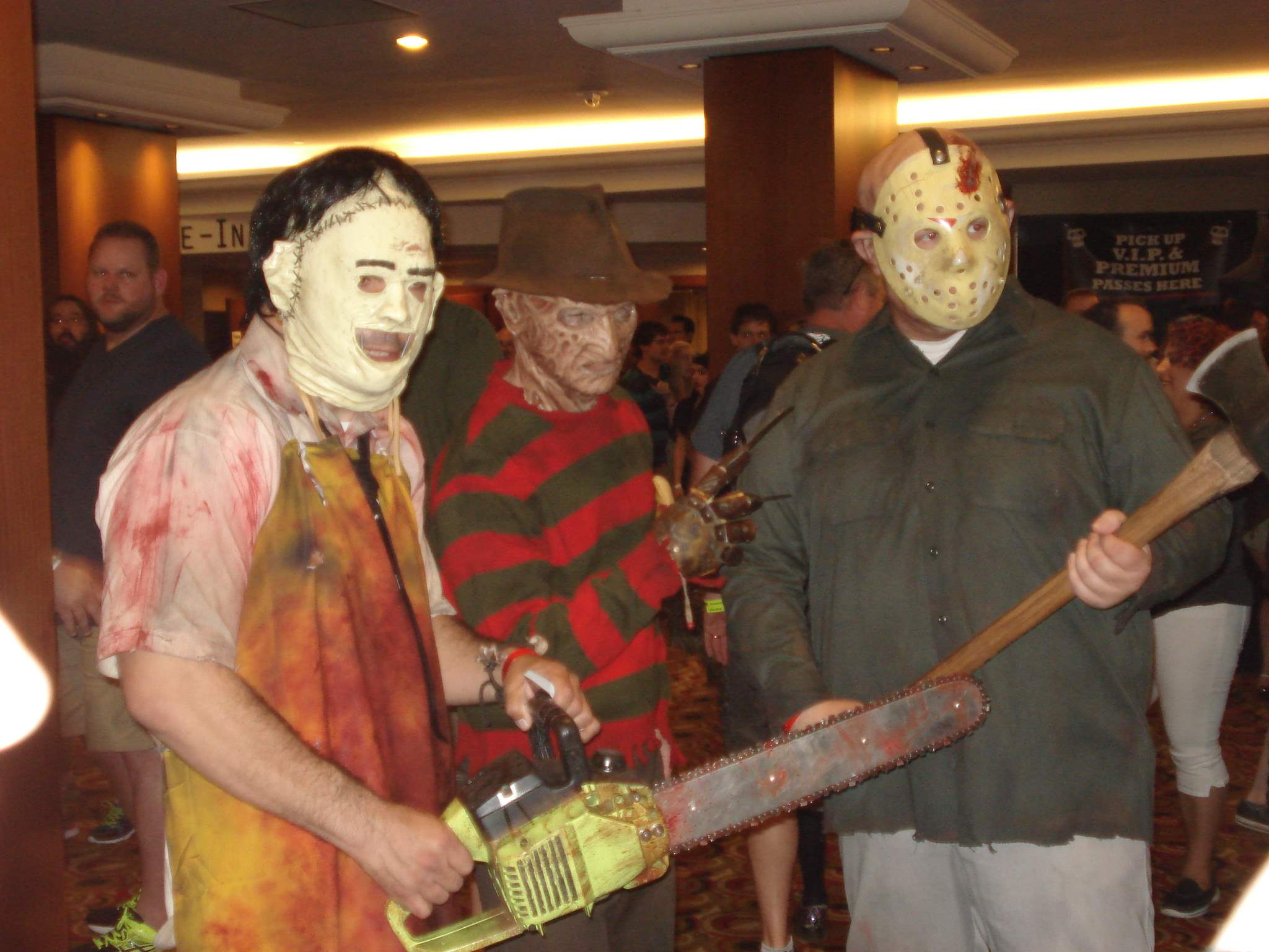 Cosplayers dressed as Leatherface, Freddy Krueger, and Jason Voorhees pose for pictures at Texas Frightmare Weekend