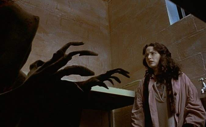 The cloaked figure of death comes for Lucy in Frank's jail cell in The Frighteners
