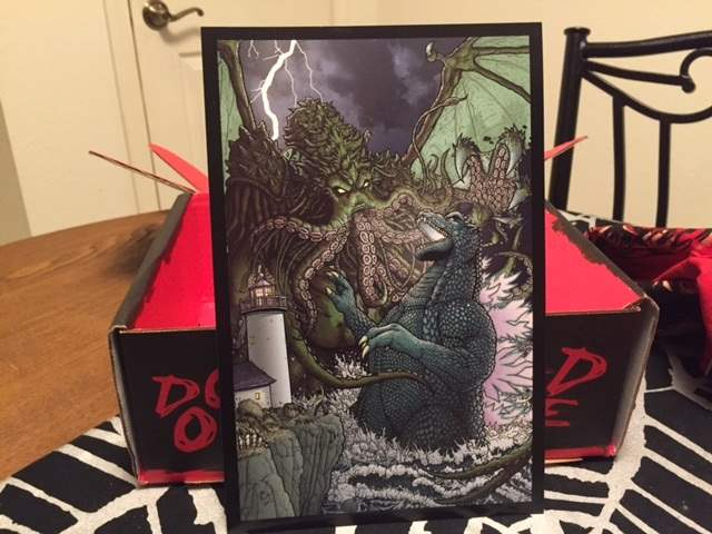 A Godzilla vs. Cthulhu print by Paul Hanley in the December 2015 Horror Block