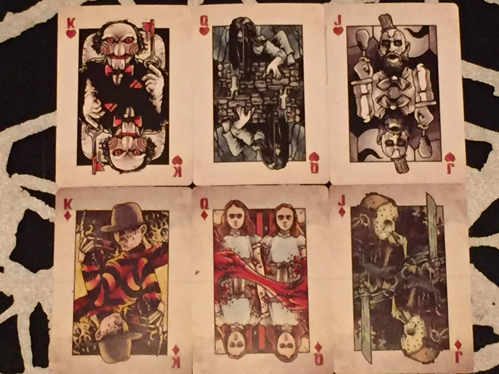 Two sets of face cards in the deck of playing cards included in February 2016's Horror Block