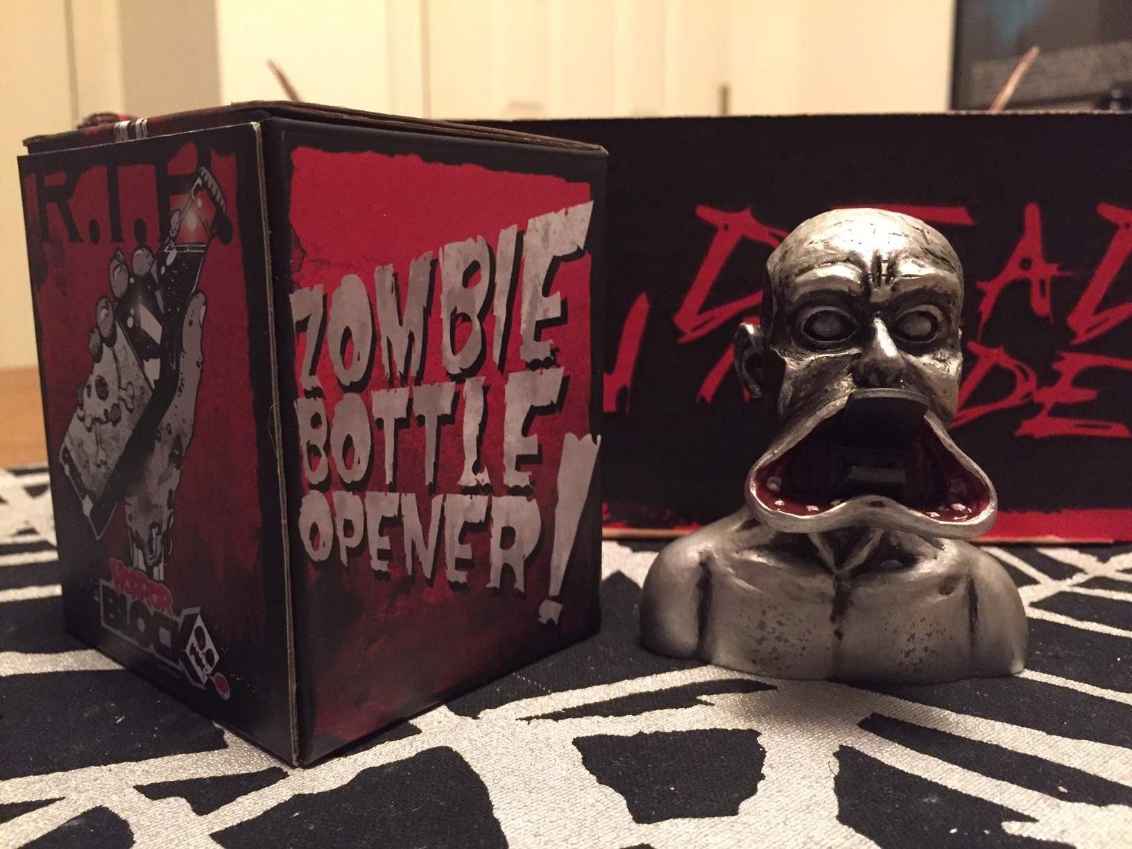 A metal zombie bottle opener in February 2016's Horror Block