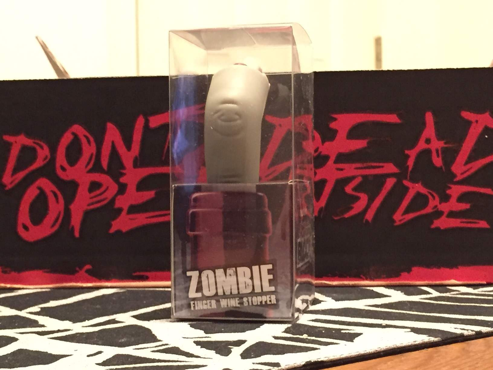 A wine stopper in the shape of a zombie finger in February 2016's Horror Block
