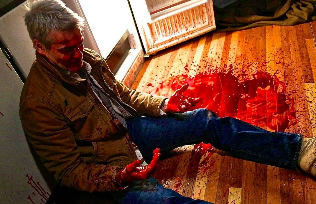 Henry Rollins bloodied in He Never Died