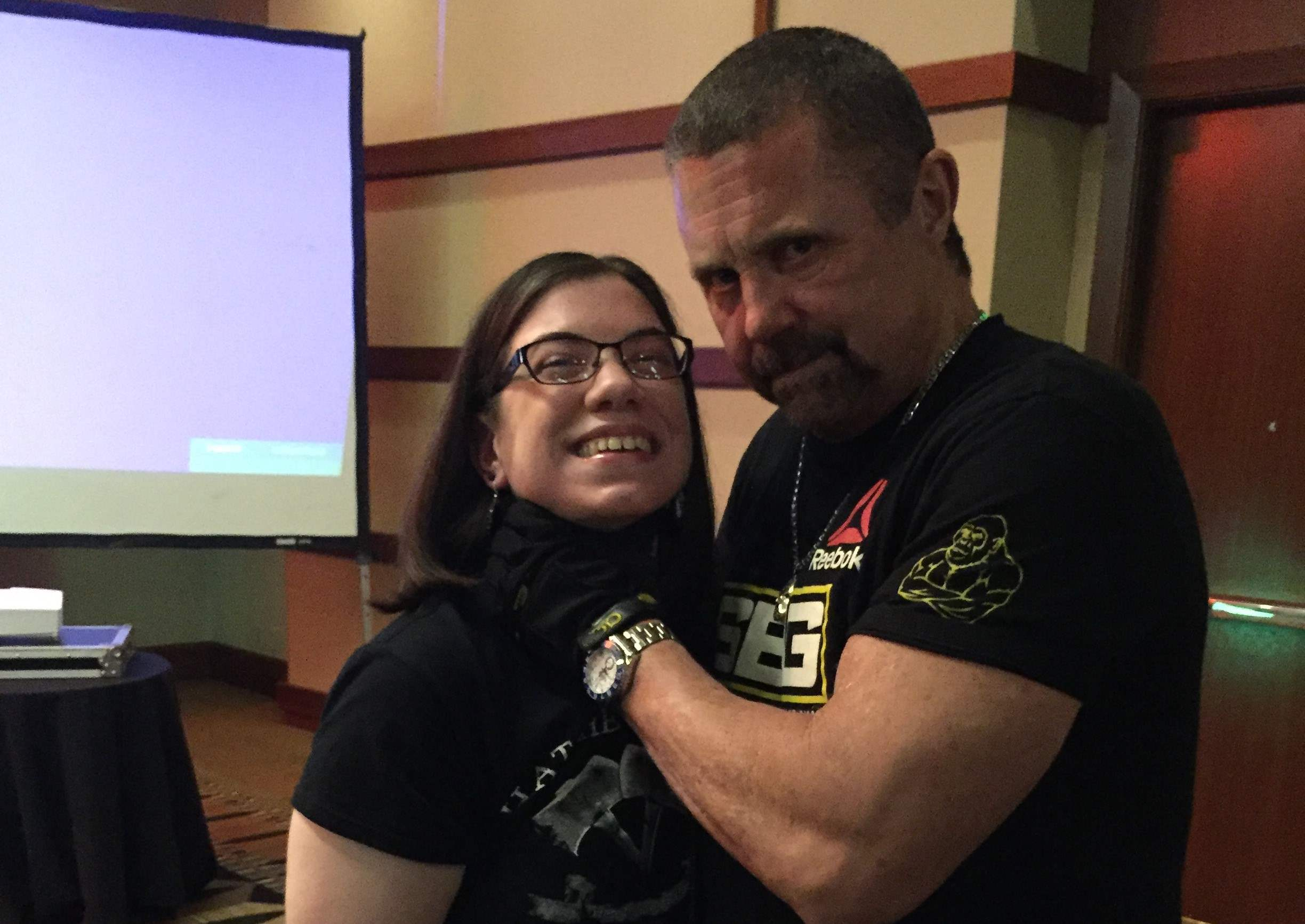 Kane Hodder puts his infamous chokehold on Michele at Texas Frightmare Weekend 2016