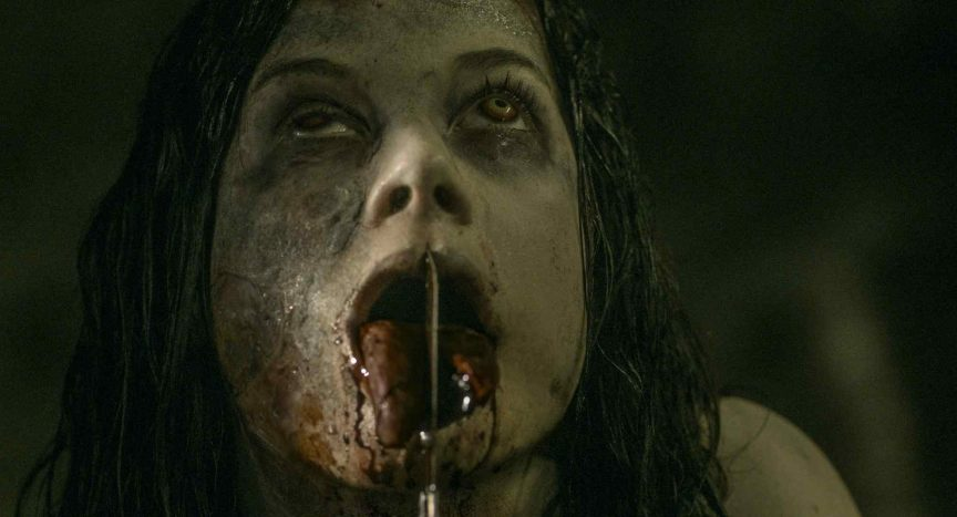 A possessed Maya (Jane Levy) slits her tongue in the remake Evil Dead 2013 - directed by Fede Alvarez.