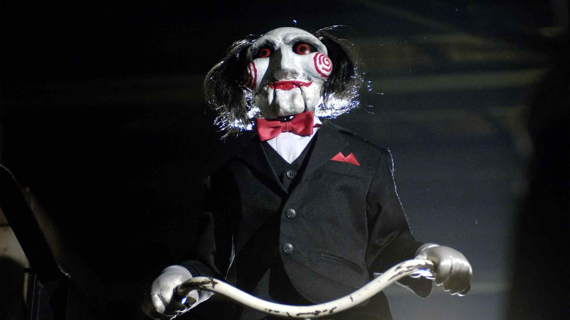 Billy the puppet in the hit Saw movie franchise.